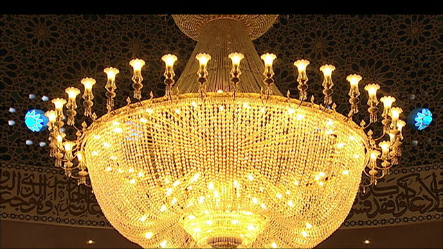 a large chandelier lights up london's central mosque. - london central mosque stock videos & royalty-free footage