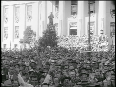 b/w 1952 large cheering crowd in front of building during eisenhower campaign / newsreel - anno 1952 video stock e b–roll