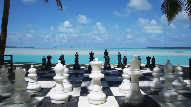 ms, large chess game on tropical resort beach, aitutaki lagoon, aitutaki, cook islands - aitutaki lagoon stock videos & royalty-free footage