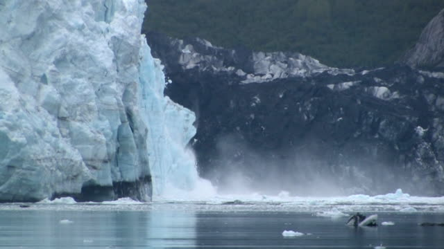MS, Large chunk of ice calving, Margerie Glacier, Tarr Inlet, Glacier Bay National Park and Preserve, Alaska, USA