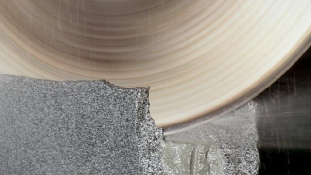 large circular saw cuts a granite block. - stone material stock videos & royalty-free footage