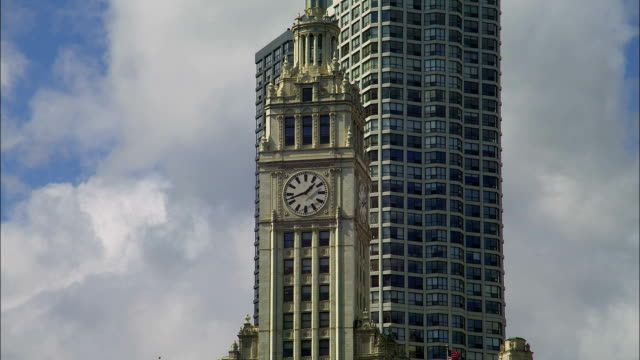 A large clock decorates the side of a tower.