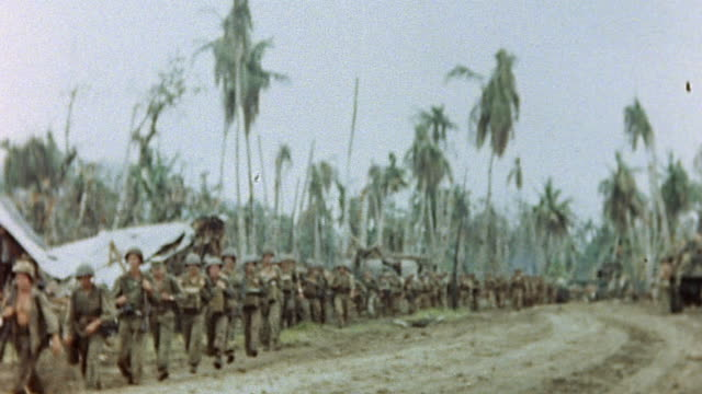 large column of us marines advancing along dirt road during wwii pacific campaign / guam mariana islands  - guam stock videos & royalty-free footage