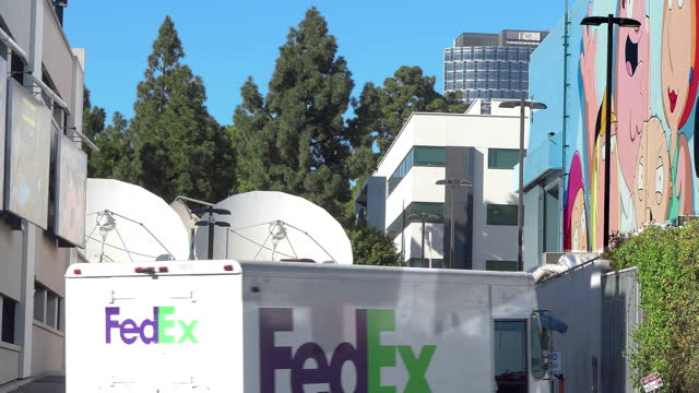 large communication satellite antennas transmit business and financial data at fox motion picture movie studios in century city, los angeles, california, 4k - studio shot stock videos & royalty-free footage
