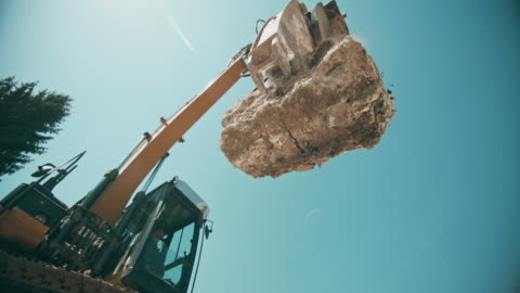 slo mo large concrete piece falling down and crushing as the excavator drops it - concrete stock videos & royalty-free footage