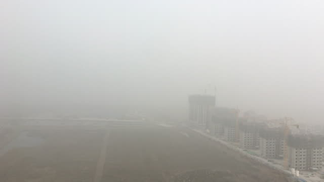 large construction site of a new residential district in a heavy hazy day on early dec tianjin and beijing suffered a severe air pollution lasting a... - smog stock videos & royalty-free footage