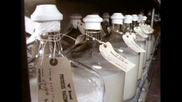 large containers full of vaccine in storage room; 1982 - archival stock videos & royalty-free footage
