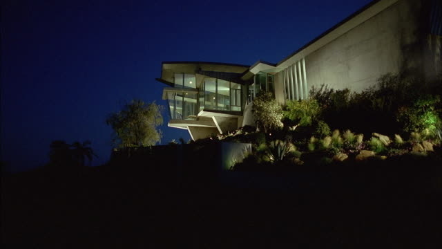 a large contemporary home illuminated at night. - malibu stock videos & royalty-free footage