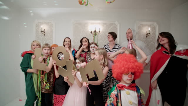 a large cospalay party with letters of love. - fancy dress costume stock videos & royalty-free footage