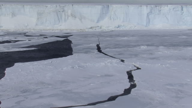 WS Large crack through sea ice and Tabular iceberg in distance / Antarctica