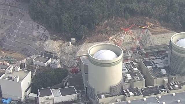 a large crane toppled in strong winds at the takahama nuclear power plant takahama fukui prefecturejapan on jan 20 causing some damage to the roofs... - nuclear energy stock videos & royalty-free footage