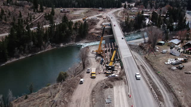 large cranes installing a bridge on a mountain road - bridge built structure stock videos & royalty-free footage
