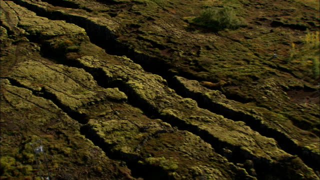 large crevasses cut across the ground near the continental drift in iceland. available in hd. - iceland stock videos & royalty-free footage