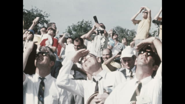 vídeos de stock e filmes b-roll de large crowd assembles for the apollo-11 launch, the first manned space craft due to land and walk on the moon from the kennedy space center in... - prt