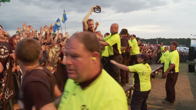 ms pan zo tu td large crowd at outdoor music festival holding flags and cameras, security people controlling crowd / knebworth, hertfordshire, uk - security staff stock videos & royalty-free footage