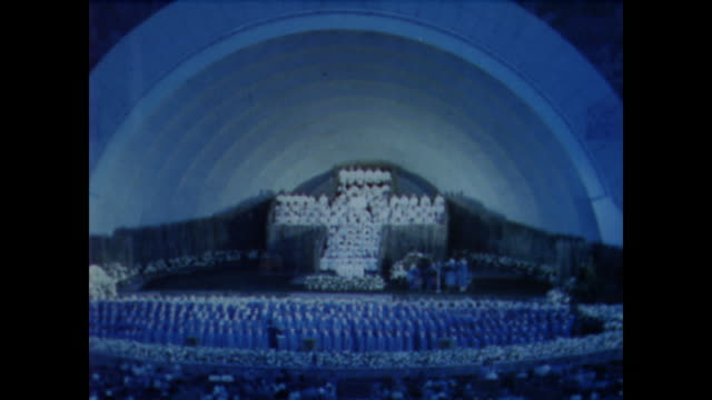 1958 large crowd enjoys gospel choir at the hollywood bowl at sunset - 賛美歌点の映像素材/bロール