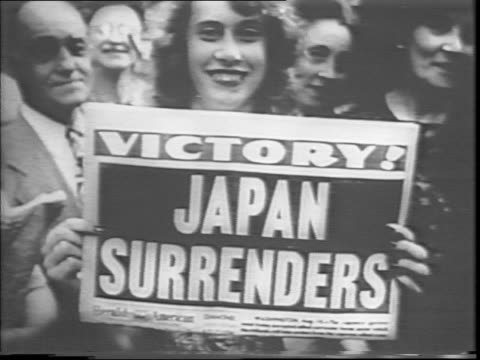 large crowd fills times square / a woman holds up a newspaper with the headline 'japan surrenders' / trains roll into and out of a city / a plane... - newspaper headline stock videos & royalty-free footage