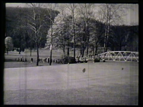 large crowd following golfers across bridge on golf course ws singer actor bing crosby golfer chris dunphy ben hogan walking across bridge crowd... - eastern usa stock videos and b-roll footage