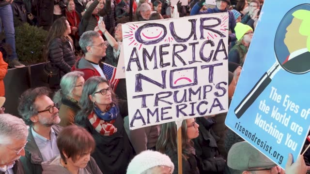 a large crowd gathered in times square during the evening midtown rushhour in opposition to president donald trump's firing of former attorney... - political rally stock videos & royalty-free footage