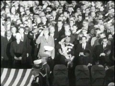 A large crowd gathers at Arlington National Cemetery before the burial of US President John F Kennedy