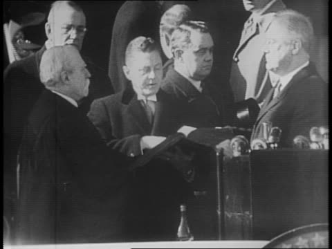 large crowd gathers to observe inauguration / montage of fdr taking the oath of office as given by chief justice charles evans hughes, crowds... - oath stock videos & royalty-free footage