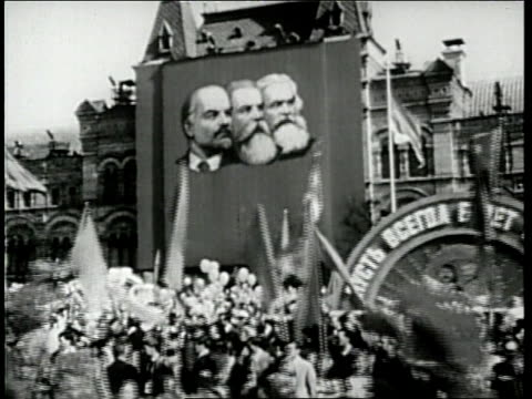 large crowd marches in a parade in the soviet union. - paraden stock-videos und b-roll-filmmaterial