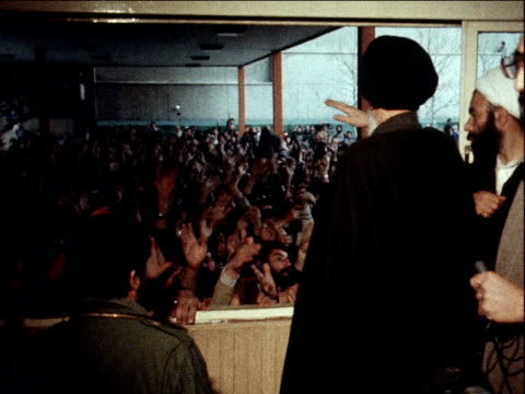 large crowd of followers chant in celebration of ayatollah khomeini's return from exile iran 3 february 1979 - イラン点の映像素材/bロール