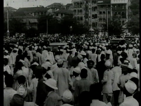 large crowd of indians on street buildings bg ws crowd of indians running jumping from tree from british imperialist soldiers w/ sticks ms british... - army stock videos & royalty-free footage