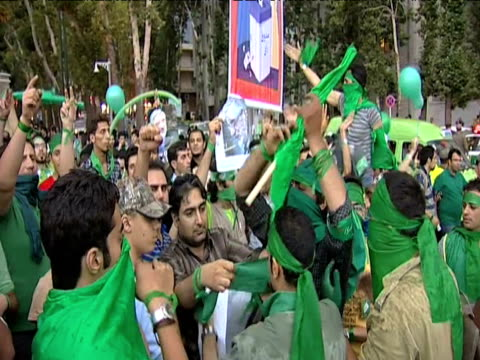 large crowd of iranians chanting in support of defeated presidential candidate mirhossein mousavi following results of elections 12 june 2009 - 2009 stock videos & royalty-free footage