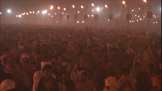 Large crowd of Kumbh Mela pilgrims advance through Allahabad, Uttar Pradesh, India