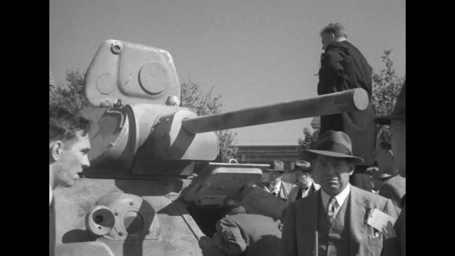 vs large crowd of mostly men wearing business suits and ties climbing all over soviet tanks on display in large field some women look at tanks / cu... - former soviet union stock videos & royalty-free footage