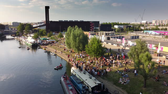 a large crowd of people dancing and enjoying the summer sunshine - riverbank stock videos & royalty-free footage