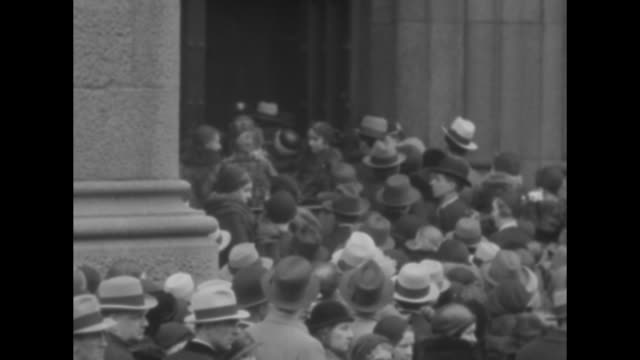 large crowd of people gathered at door of st patrick's cathedral / welldressed people strolling along some men in top hats one with a walking stick... - st. patrick's cathedral manhattan stock videos and b-roll footage