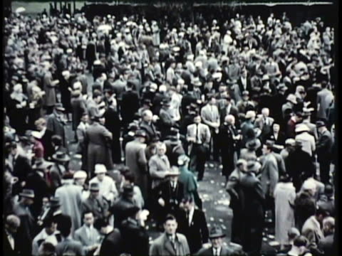 stockvideo's en b-roll-footage met 1955 montage ws ms ha large crowd of people outdoors / new zealand / audio - 1955