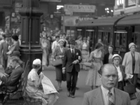 large crowd of people walk along a railway platform towards the camera at victoria station. 1958. - number of people stock videos & royalty-free footage