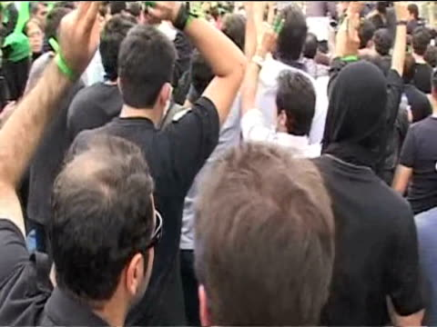 Large crowd of protesters chanting in support of defeated presidential candidate Hossein Musavi at rally 18 June 2009