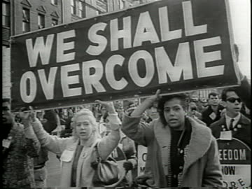 """large crowd of protestors walking from selma to montgomery for equal voting rights for african americans, holding a sign """"we shall overcome"""". - 1965 stock videos & royalty-free footage"""