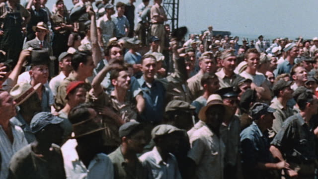 Large crowd of shipyard workers watching at launching of USS Yorktown / Newport News Virginia United States