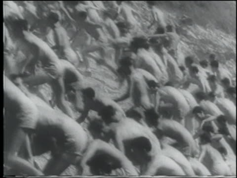 b/w 1943 large crowd of shirtless men running up hill / us navy cadets - shirtless stock videos & royalty-free footage