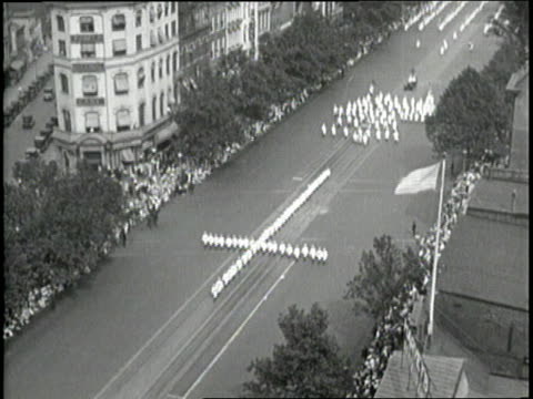 A large crowd of the Ku Klux Klan members march in a parade on Pennsylvania Avenue NW near the Capitol Building in Washington DC on August 8 1925...