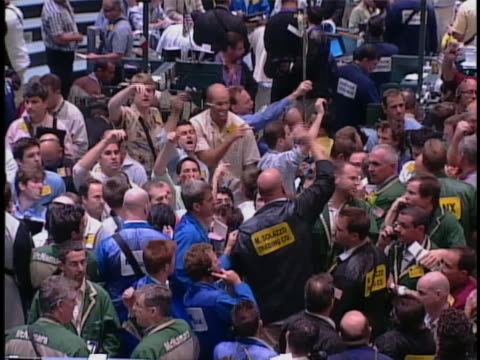 large crowd of traders make transactions on the floor of the new york stock exchange. - finance stock videos & royalty-free footage