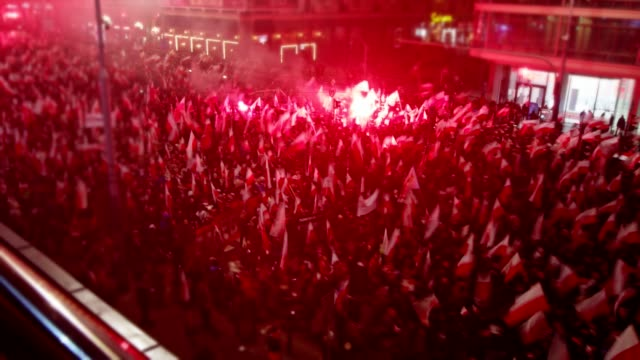 large crowd on independence march. flags and flares. polish national holiday - marching stock videos & royalty-free footage