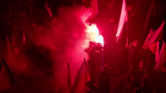 large crowd on independence march. flags and flares. polish national holiday - demonstration stock videos & royalty-free footage