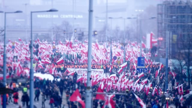 large crowd on independence march. flags and flares. polish national holiday - marching stock videos and b-roll footage