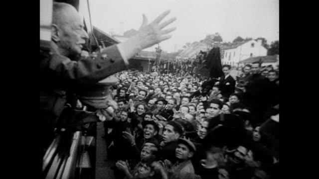 / large crowd packed into portuguese capital / reelected president antonio carmona drives slowly through the waiting crowd / everyone waving and... - 1949 stock videos & royalty-free footage
