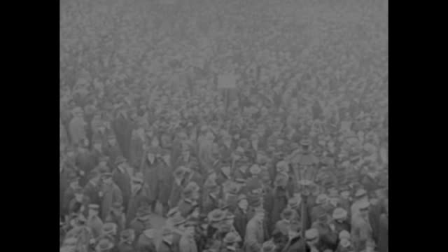 ws large crowd pouring through brandenburg gate and coming down unter den linden avenue / three overhead shots of large crowd gathered in unter den... - 1910 1919 stock videos and b-roll footage
