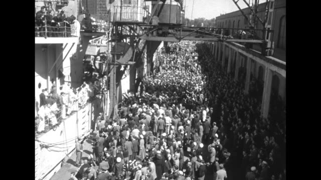 large crowd walking down street / two priests standing in car as it drives down street in crowd / overhead shot of crowd on dock next to ship /... - priest stock videos & royalty-free footage