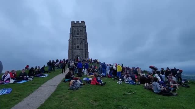 large crowd was seen at glastonbury tor to celebrate the summer solstice monday, june 21 while stonehenge was closed due to covid-19 restrictions. - rock formation stock videos & royalty-free footage