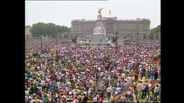 large crowds chanting and cheering outside buckingham palace on the day of the wedding of prince charles and lady diana spencer; 1981. - english culture stock videos & royalty-free footage