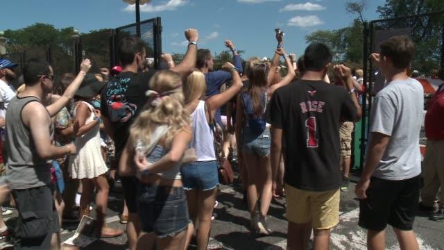 large crowds enter lollapalooza music festival in chicago on july 31, 2015. - お祭り好き点の映像素材/bロール